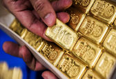 قیمت هر اونس طلا به ۱۵۷۴ دلار و ۶۹ سنت کاهش یافت