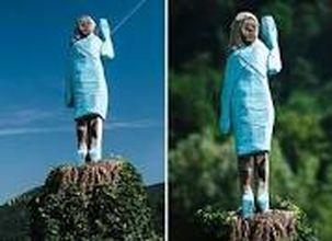 تصاویر بریدن و پایین آوردن مجسمه چوبی ملانیا ترامپ در اسلونی زادگاه وی
