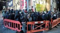 تصاویری از صف طولانی مشتریان برای ورود به یک فروشگاه در انگلیس + فیلم
