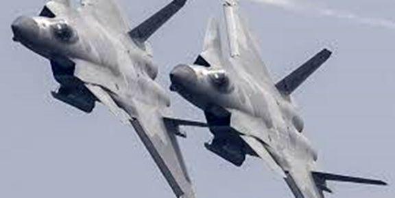 چین پرواز  هفت فروند جنگنده پیشرفته جی-20 را  به نمایش گذاشت